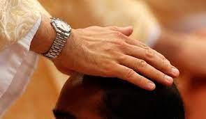 Misa con imposición de manos